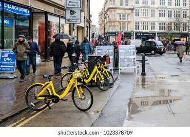 Oxford England UK 10/02/2018: Yellow bike for hire Broad St Oxford