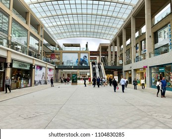 OXFORD - MAY 25, 2018: Pedestrians inside the Westgate Shopping Centre in Oxford, UK.