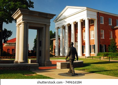 Oxford, MS, USA July 21, 2010 a statue of James Meredith, walking through an open door, honors the the first African American to attend the University of Mississippi