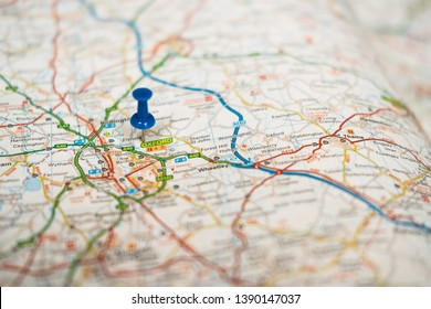 Oxford, Oxfordshire, UK - Circa May 2019: Very shallow focus of a blue push pin located at the university city of Oxford, England. Showing mapping detail and roads of this famous city.