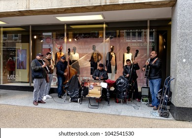 Oxford, Oxfordshire, UK - March 26, 2016: A street busking band