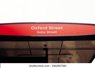Oxford street bus stop in the center of London, UK. A bus stop is a designated place where buses stop for passengers to board or alight from a bus.