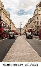 Oxford street, London, blur traffic, red buses and black taxis