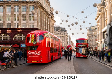 OXFORD STREET, LONDON - OCTOBER 26: London's Oxford Street full of shoppers, several red London Buses. On Oxford Street, London, England on 26th October 2015.