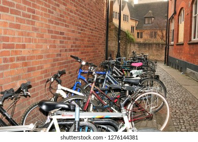 Oxford, UK 04.01.2019 - Row of push bikes in an alleyway in Oxford.