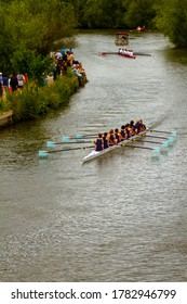 Oxford, UK 06/04/2011: Traditional annual summer eights rowing competition in Oxford. Teams of eight row in long boats with a coxswain in river Thames. Spectators watch the event from the river banks.