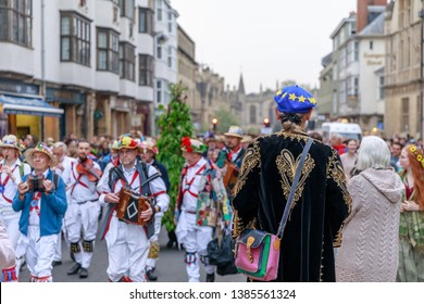 Oxford, UK. 1st May, 2019.  As crowds leave May Day celebrations, lead by Morris Dancers, a man in an EU hat watched on.