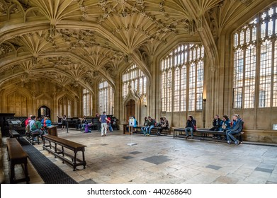Oxford, UK - August 12, 2015: Interior of Bodleian Library with tourists. The fie architecture of the Library has made it a favourite location for filmmakers, including Harry Potter