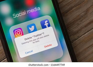 OXFORD, UK - AUGUST 22nd 2018: A Twitter user deletes the social media app from a smartphone device.