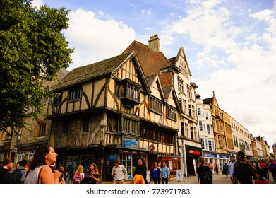 OXFORD, UK - AUGUST 23, 2017: Cornmarket Street (major shopping street and pedestrian area) crowded with tourists and locals.