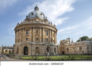 Oxford, UK - August 27, 2014: view of the Radcliffe Camera with All Souls College in Oxford, UK. The historic building is part of Oxford University Library.