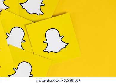 OXFORD, UK - DECEMBER 5th 2016: Snapchat logos printed onto paper. Snapchat is a popular social media application for sharing messages, images and videos