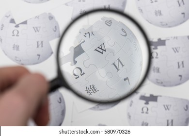OXFORD, UK - FEBRUARY 16th 2017: Wikipedia logo printed onto paper. Wikipedia is a free online encyclopedia.