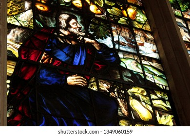 OXFORD, UK - JANUARY 28, 2019:Close up of Jonah Window in Christ Church Cathedral, oxford