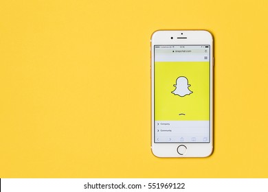 OXFORD, UK - JANUARY 9th 2017: An apple iPhone showing the Snapchat application on a bright yellow background. Snapchat is a popular social media application for sharing messages,  images and videos