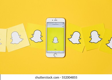 OXFORD, UK - JANUARY 9th 2017: An apple iPhone showing the Snapchat application alongside other Snapchat logos. Snapchat is a popular social media application for sharing messages,  images and videos