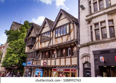 Oxford, UK - June 08, 2015: Cornmarket Street, or just 'Cornmarket' as it is known in the city, is Oxford's main shopping street. Containing many commercial big chain shops