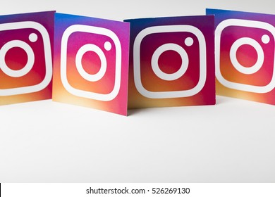 OXFORD, UK - NOVEMBER 30th 2016: A collection of Instagram logos printed onto paper. Instagram is a popular social media application for sharing images and videos