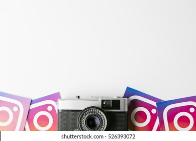 OXFORD, UK - NOVEMBER 30th 2016: Instagram logos printed onto paper with a retro vintage film camera. Instagram is a popular social media application for sharing images and videos