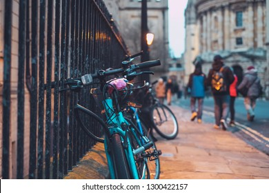 OXFORD, UNITED KINGDOM - January 28, 2019:  Bicycles at the gate taken in Oxford university, England. Oxford is bicycle friendly city for cyclers