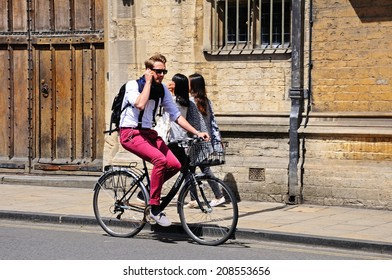 OXFORD, UNITED KINGDOM - JUNE 17, 2014 - Cyclist passing Brasenose College along High Street, Oxford, Oxfordshire, England, UK, Western Europe, June 17, 2014.