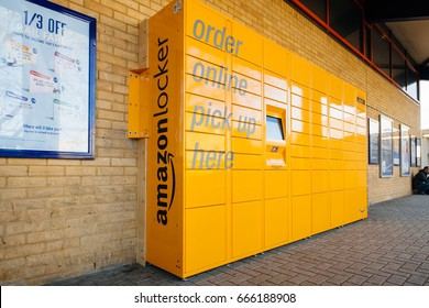 OXFORD, UNITED KINGDOM - MAR 2, 2017: Side view of Amazon locker orange delivery package locker in public place at the train station in Oxford - Amazon Locker is a self-service parcel delivery service