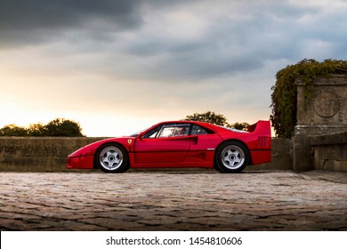 Oxfordshire, England - September 2018: classic red Ferrari F40 supercar, only 1311 of which were made by the Italian brand between 1987 and 1992, attending annual Salon Prive event.