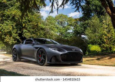 Oxfordshire, England - September 2018: front three-quarters view of a black Aston Martin DBS Superleggera supercar attending annual Salon Prive event, held in Oxfordshire.