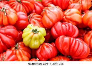 Oxheart tomato is a large beefsteak type tomato, resembling an ox heart, which is a sweet pink red fruit low in seeds