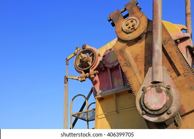 oxidation rust pumping unit parts under blue sky in oilfield