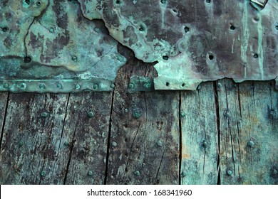 Oxidized copper and decayed wood background.