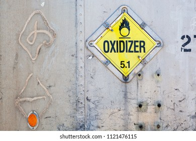 Oxidizer hazardous material placard on transport container