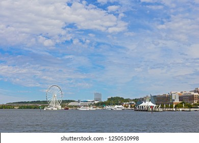 OXON HILL, MARYLAND, USA - SEPTEMBER 11, 2016: National Harbor panorama Potomac River waterfront, Ferris wheel and MGM National Harbor casino building scheduled to be opened on December 8, 2016.