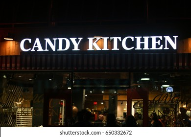 Oxon Hill, MD - May 28, 2017: The Candy Kitchen store lit up at National Harbor.