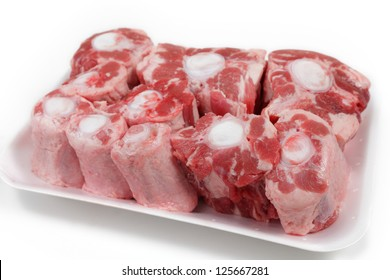 An oxtail, cut into segments and presented on a supermarket-style polystyrene tray
