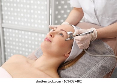 Oxygen infusion. A woman in a beauty salon during a care treatment using active oxygen