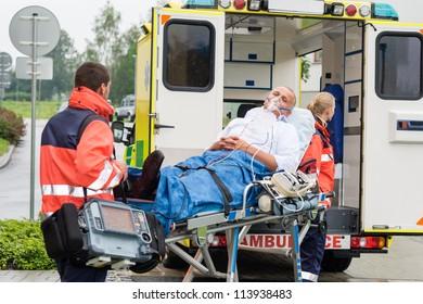 Oxygen mask male patient ambulance stretcher emergency transport hospital