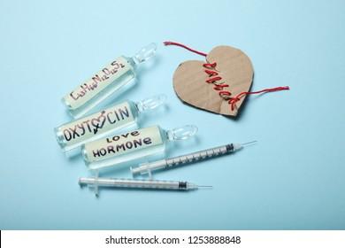 Oxytocin injections concept. Love hormone. Broken heart.