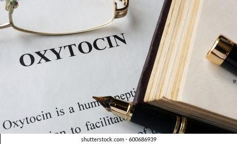 Oxytocin written on a page. Human hormones.