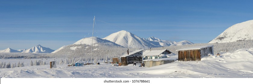 Oymyakon, Yakutia - February 07 2018: Weather Station Vostochnaya in the Oymyakon district on the background of a mountain landscape