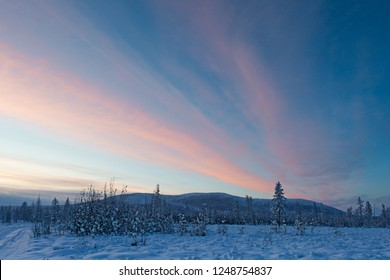 Oymyakon, Yakutia, Siberia, Russia. Purple sunset in Oymyakon - Pole of Cold. The Oymyakon is located in the northeast of Yakutia. This is the coldest inhabited place on the planet. Copy space