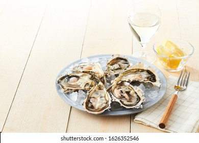 Oyster bar on white wooden table