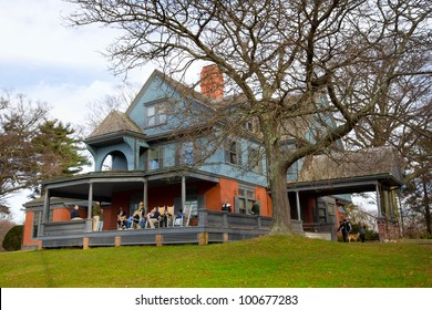 OYSTER BAY, NY - NOV. 27:  Visitors on porch at National Historical Site, Sagamore Hill seen on Nov. 27, 2011.  Sagamore Hill was the home of President Theodore Roosevelt in Oyster Bay Long Island NY.
