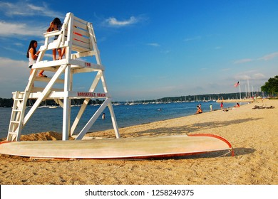Oyster Bay, NY, USA June 30, 2009 Two teen girls chat on an empty lifeguard stand on the seashore in Oyster Bay, New York