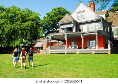 Oyster Bay, NY, USA June 30, 2009 A family strolls the grounds of Sagamore Hill, President Theodore Roosevelt's home in Oyster Bay, New York