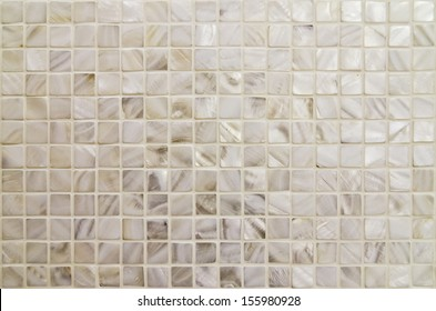oyster shell textured mosaic tiles in neutral color
