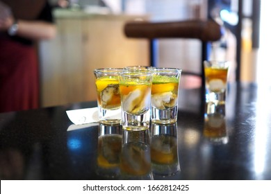 Oyster Shooters. Oyster with mint and egg in shot glass. selective focus.