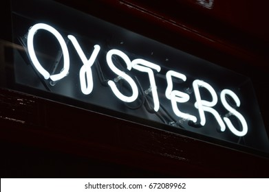 oyster sign at the bar