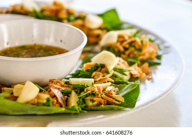 oyster of thailand  set in the dish with vegetables and herbs and seafood chilli sauce.