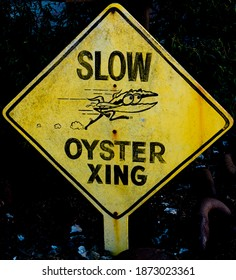 An oyster xing (crossing) sign is posted at Tomales Bay, in Marin County, California, home to world famous oyster farms.